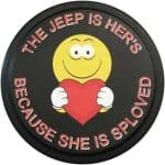 a funny smiley face tire cover