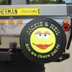 Personalized smiley face tire cover